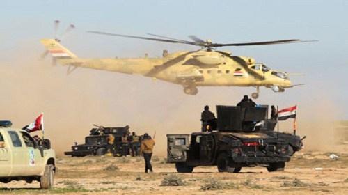 الشرطة الاتحادية وطيران الجيش يستطلعان مطار الموصل استعدادا لأقتحامه