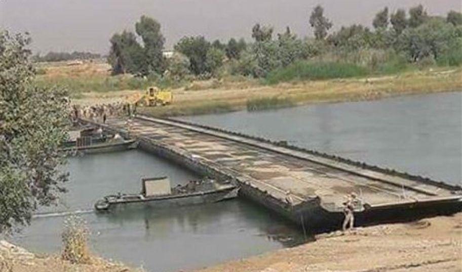 عمليات نينوى تباشر بنصب جسر عائم جديد يربط جانبي الموصل