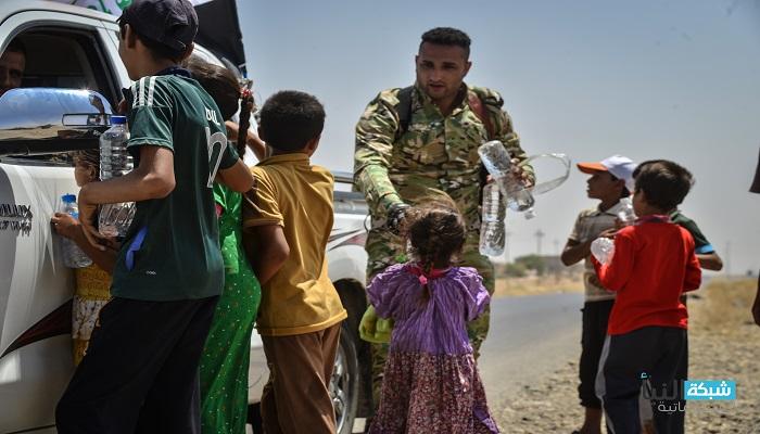 اللواء 313 في الحشد يعيد عددا من العوائل النازحة الى غرب سامراء