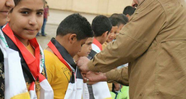 مكتب الحشد في الديوانية يكرم أبناء الشهداء في مدرسة بالمحافظة