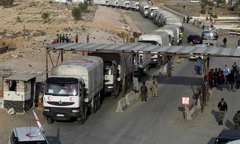 خروج 4 آلاف مسلح وأسرهم عبر معبر مخيم الوافدين القريب من دوما