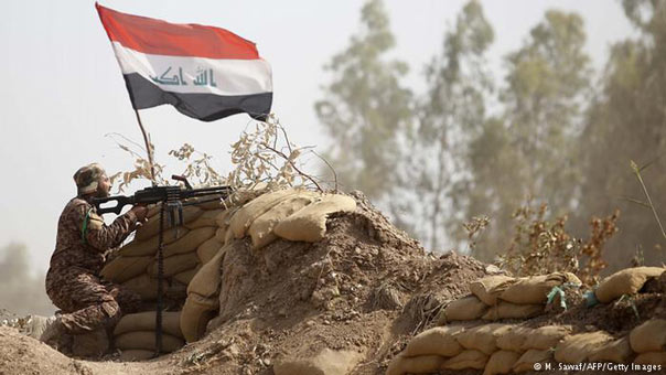 الحشد الشعبي يشتبك مع ارهابيي داعش قرب جسر الفتحة