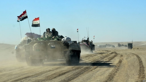 الحشد الشعبي ضربات صاروخية تسقط 20 داعشيا في الجانب السوري