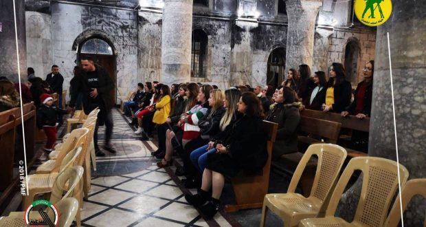 المسيحيون يحيون قداس ليلة عيد الميلاد في كنائس الموصل بحماية الحشد الشعبي