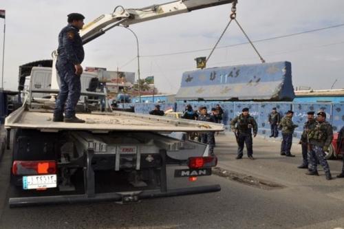 الشرطة الاتحادية ترفع عدداً من سيطراتها في بغداد بينها الكرادة