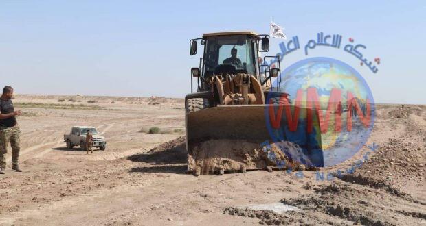 هندسة الحشد تشرع بإنشاء سدة ترابية لإحتواء جريان نهر السويب شمال البصرة