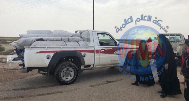 الحشد الشعبي يوزع 100 خيمة للعوائل التي نزحت جراء السيول و الفيضانات جنوب ميسان