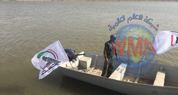قوات الرسول البحرية التابعة للحشد الشعبي تشرع بجهود درء مخاطر الفيضانات شمال البصرة