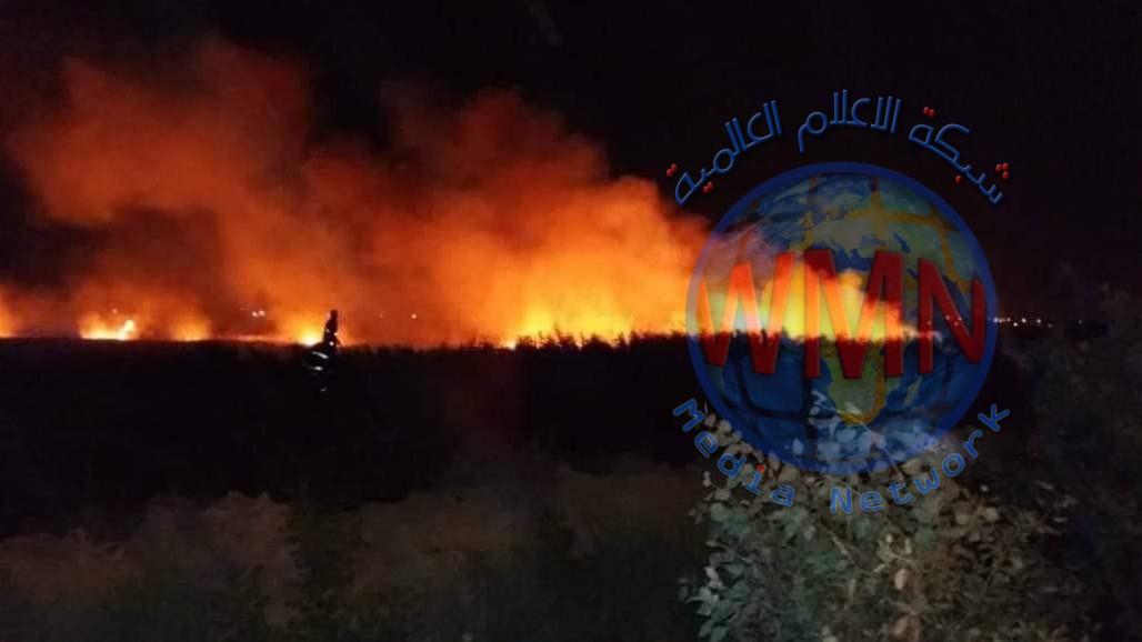 اخماد حريق واسع في ارض زراعية بمركز الكوت