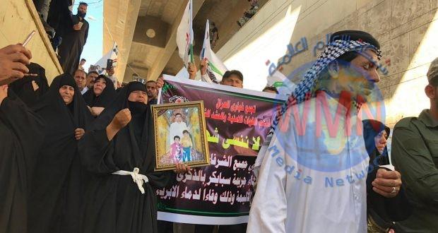 .الحشد الشعبي يشرف على ايصال عوائل مجزرة تكريت لمكان الجريمة