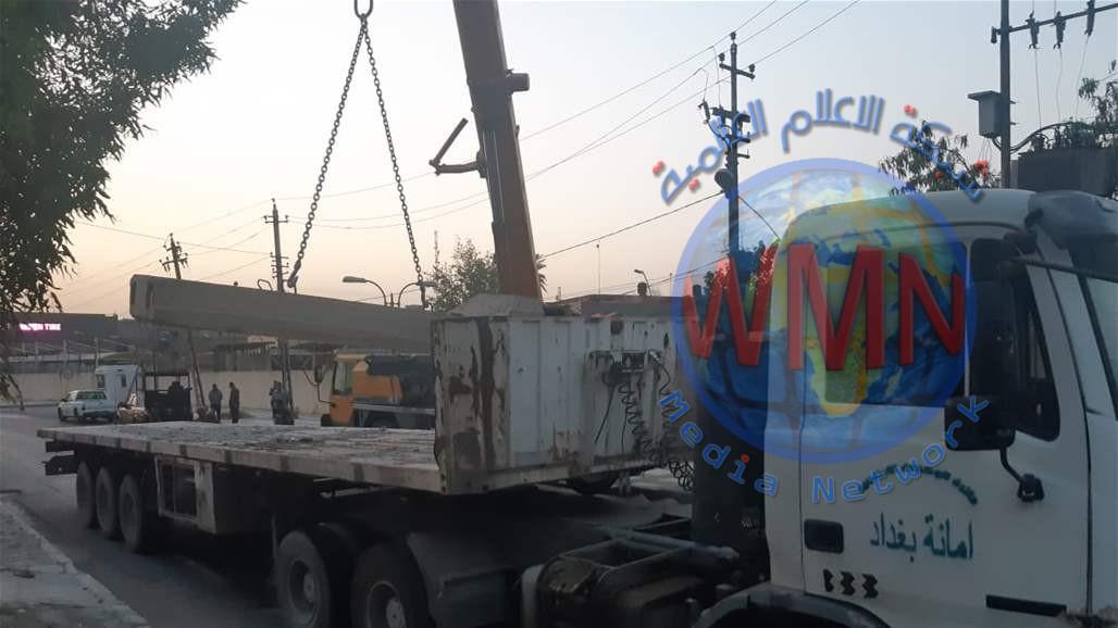 رفع الكتل الكونكريتية من محيط مقر تابع للحشد وسط بغداد