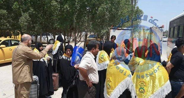 الحشد الشعبي في الديوانية ينظم رحلة لعوائل شهداء سبايكر لزيارة المراقد المقدسة في ايران