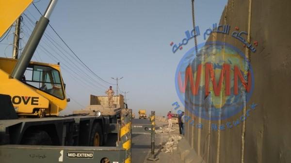 رفع الكتل الكونكريتية عن موقعين وفتح شارع مغلق في بغداد