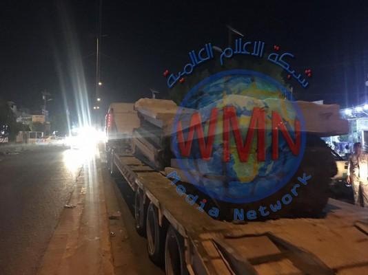 رفع الكتل الكونكريتية من محيط مصرف الرافدين بمدينة الصدر