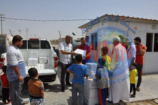 توزيع 400 سلة غذائية و صحية للاسر النازحة في ذي قار