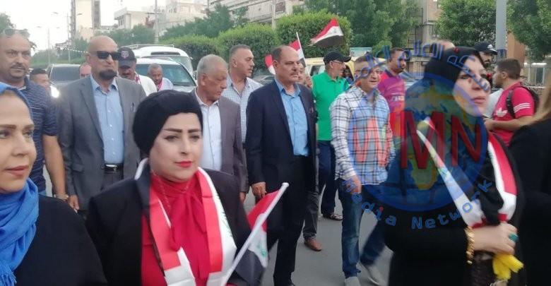 مسيرة راجلة لصحفيي العراق الى ساحة التحرير يتقدمها نقيب الصحفيين العراقيين