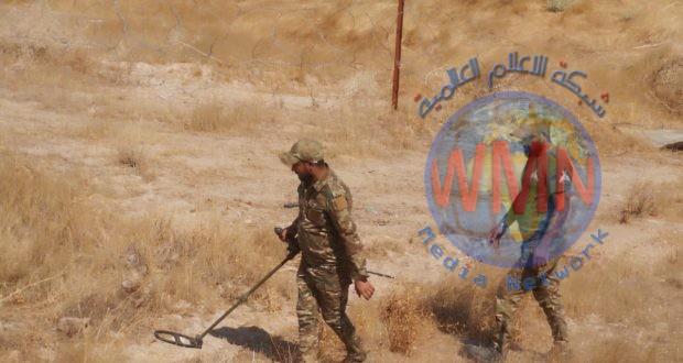 مديرية مكافحة المتفجرات في الحشد تطهر منطقة الحمرة في بيجي من المخلفات الحربية