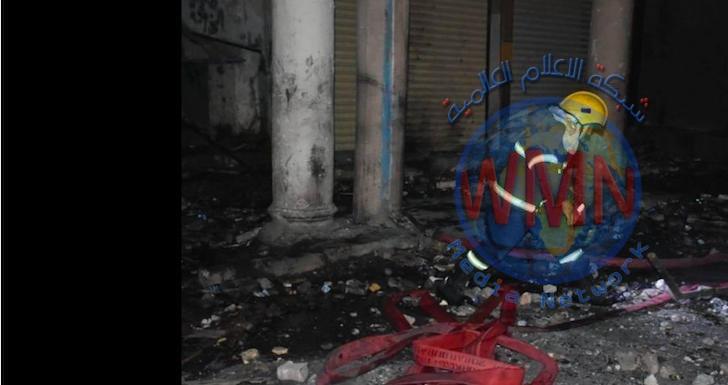 الدفاع المدني يخمد حريق داخل بنايتين في شارع الرشيد وسط بغداد