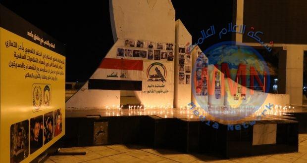 مقاتلو اللواء السابع بالحشدالشعبي يوقدون الشموع بالبصرة حدادا على ارواح شهداء التظاهرات
