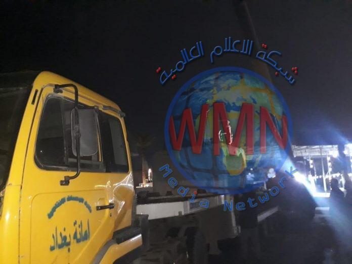 امانة بغداد ترفع الكتل الكونكريتية من محيط شارع جنوبي العاصمة