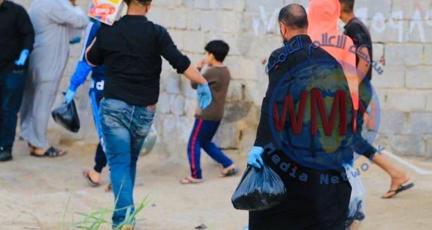 الحشد الشعبي في بابل ينظم حملة لتوزيع السلال الغذائية مع المعقمات على العوائل الفقيرة بالمحافظة
