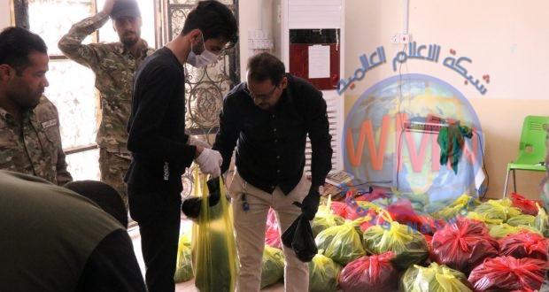 اللواء الأول في الحشد الشعبي يوزع ٢٥٠ سلة غذائية بين العوائل المتعففة شمال البصرة