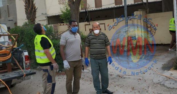 الحشد الشعبي يعفر منازل المصابين بكورونا في بابل (صور)
