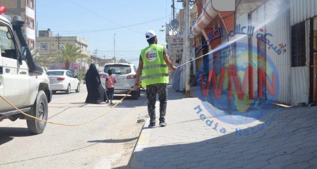 الحشد الشعبي ينفذ حملة تعفير في حي السلام بالنجف (صور)