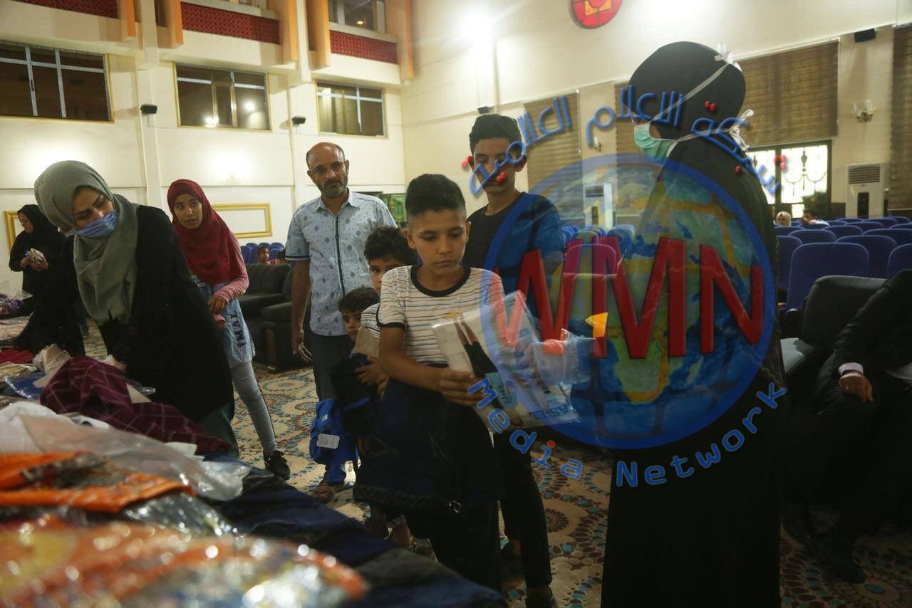 معاونية شؤون الشهداء في الحشد وبالتعاون مع غرفة تجارة بغداد توزعان كسوة العيد على اطفال شهداء الحشد