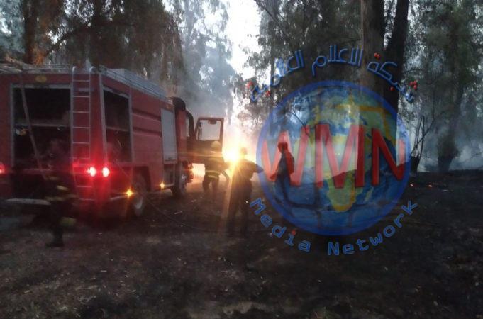 قيادة عمليات نينوى للحشد تشارك بإخماد حريق في منطقة الغابات بالموصل