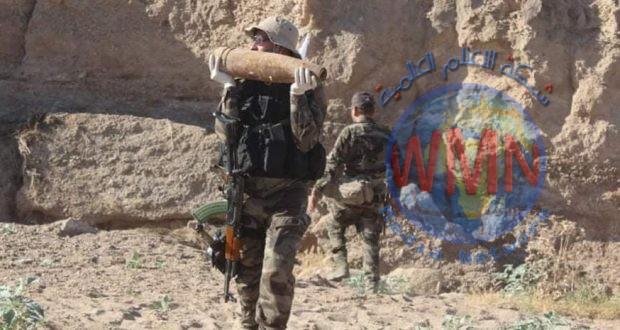 قوة من الحشد الشعبي تعثر على مضافة لداعش تحوي أسلحة ومواد تفجير في جرف النصر