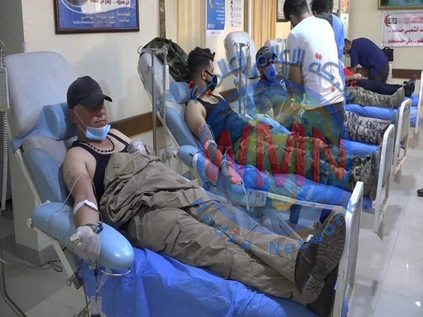 الحشد الشعبي يستجيب لنداء مصرف الدم الرئيس في كركوك وينقل المتبرعين إليه