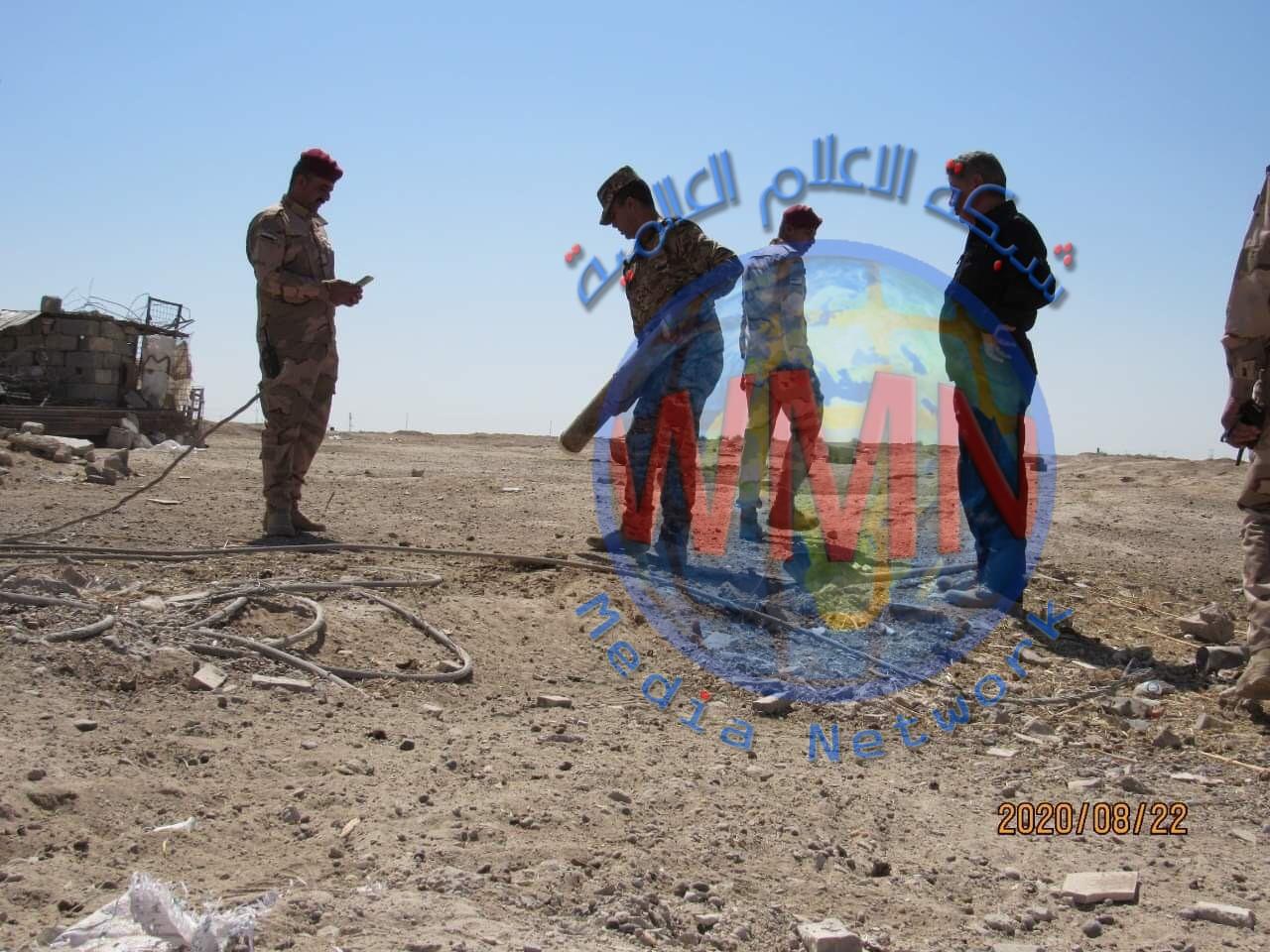 الحشد الشعبي والجيش يرفعان المخلفات الحربية لداعش من قرية شرق الانبار