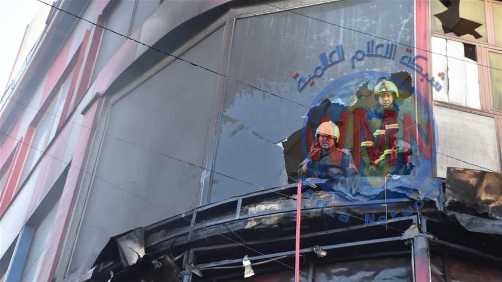 الدفاع المدني يخمد حريقاً داخل بناية الدفتر دار وسط بغداد