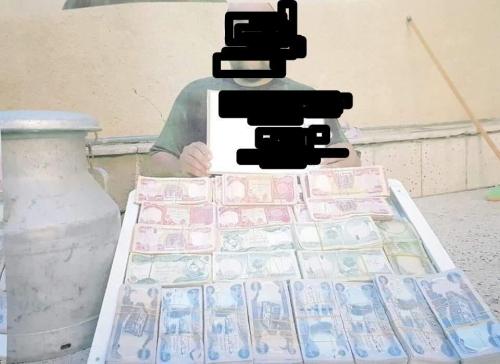 بالصور..ضبط {43} مليون دينار تعود لداعش غرب الموصل