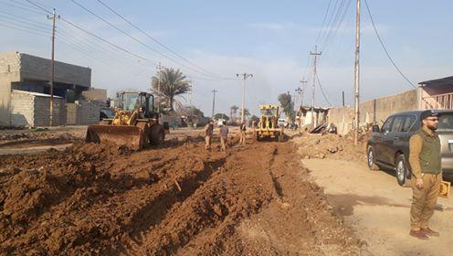 الجهد الهندسي للحشد يشرع بتأهيل وتنظيف شوارع قضاء بلد