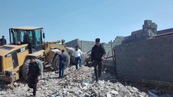 إزالة دور متجاوزة شرقي بغداد