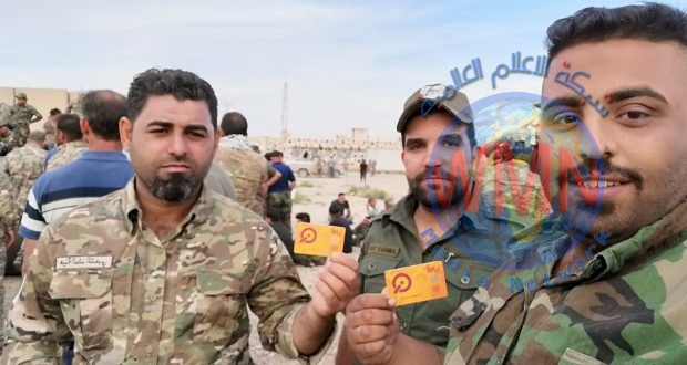 """مالية الحشد الشعبي تسلم مقاتلي اللواء 41 بطاقة """"الكي كارد"""" وتجدد التاكيد بانها عازمة على مواصلة نهج الشفافية"""