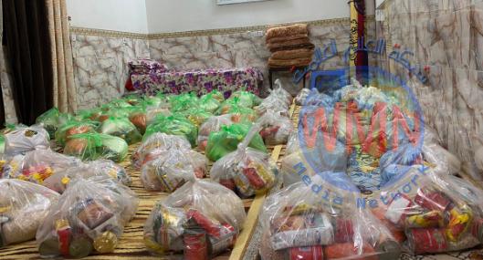 بالصور.. اللواء 33 يوزع مساعدات غذائية في حزام بغداد