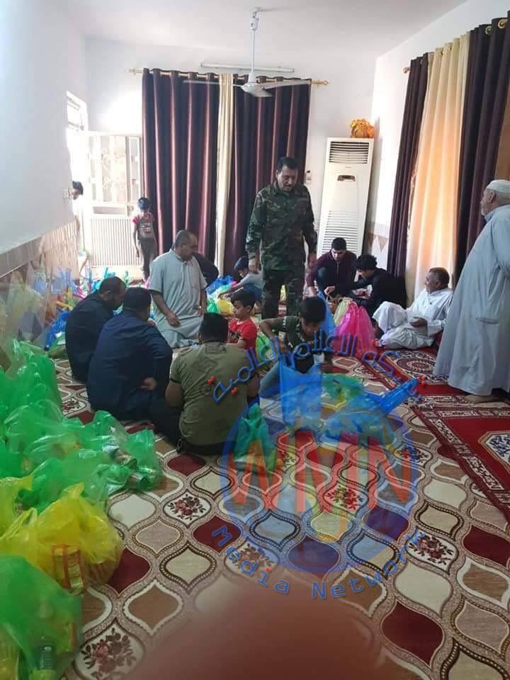 اللواء 22 في الحشد يباشر بتوزيع 250 سلة غذائية على العوائل المتعففة في ميسان (صور)