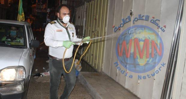 متطوعون ومعاونية شؤون الشهداء والمقاتلين في الديوانية يعفران منطقة سوق التجار الكبير وسط المحافظة