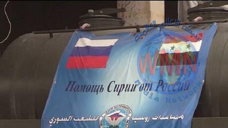 توزيع مساعدات إنسانية روسية في قرية قرب حلب