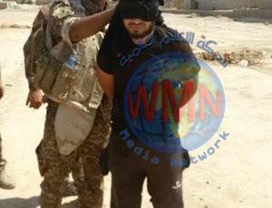 """القبض على 12 """"إرهابياً"""" وضبط عبوات وأحزمة ناسفة وصواريخ في الأنبار"""