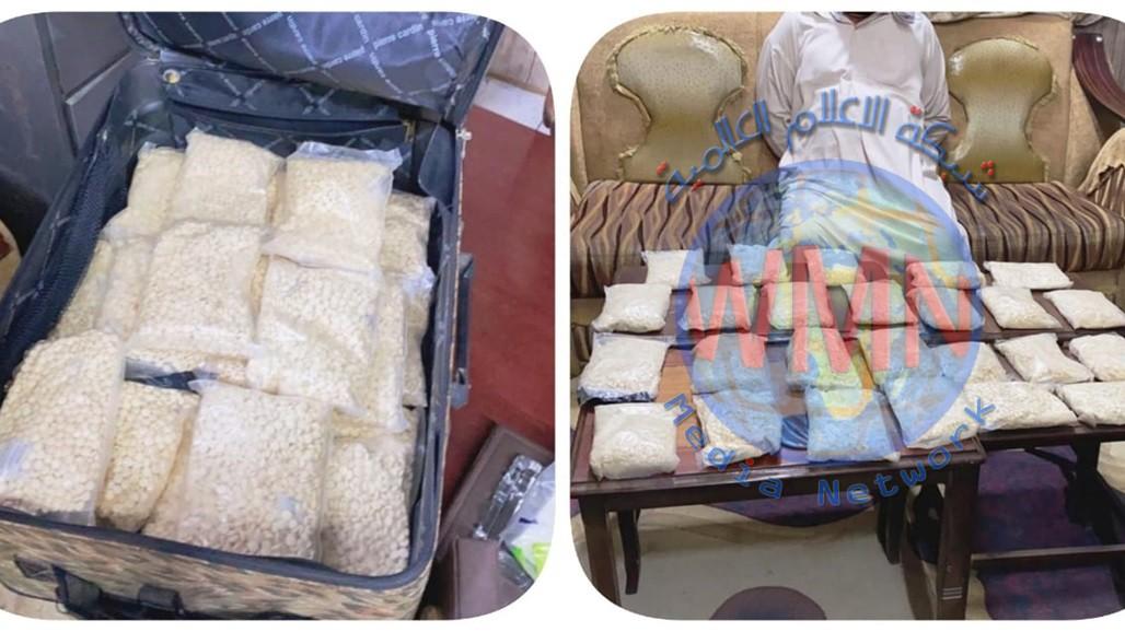 القبض على متهم ضبط بحوزتة كميات كبيرة من الحبوب المخدرة في النجف